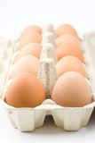 Brown eggs. Focus on first two eggs Royalty Free Stock Photos
