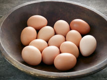 Brown eggs. In a wooden bowl on a rustic table Royalty Free Stock Photography