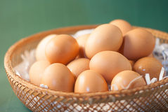Brown eggs in basket Stock Photos
