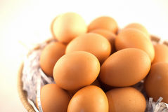 Brown eggs in basket Stock Images