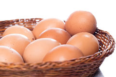 Brown eggs in basket. Close up of brown eggs in basket Stock Photo