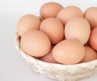 Brown eggs in a basket Stock Images