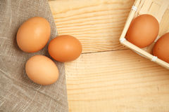 Brown Eggs in basket with homespun fabric close up Stock Images