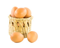 Brown eggs in basket isolated on white Royalty Free Stock Photo
