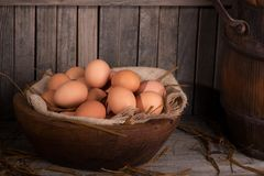 Brown Eggs in a Bowl. Brown chicken eggs in a wooden bowl with rustic background Royalty Free Stock Photography