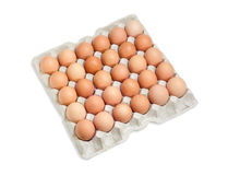 Brown eggs in the cardboard egg tray on light background Royalty Free Stock Photography