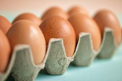 Brown eggs in cardboard packing. Ecological packing. Happy Easter. Selective focus. Front view royalty free stock photography