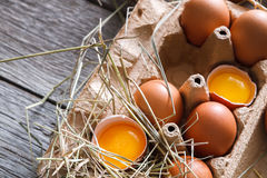 Brown eggs carton. Healthy food background. Yellow yolk Stock Photography