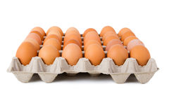 Brown eggs in a carton. Isolated on a white background Royalty Free Stock Images