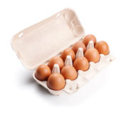 Brown eggs in a carton package  on white Royalty Free Stock Photos