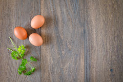 Brown eggs composition top view wooden background Stock Images