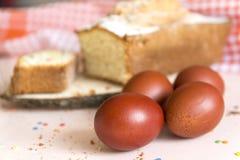 4 brown eggs, cupcake, Easter royalty free stock photos
