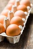 Brown eggs in egg box. The brown eggs in egg box on kitchen table Royalty Free Stock Photo