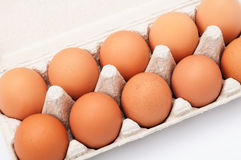 Brown eggs in egg box. Closeup Royalty Free Stock Photography
