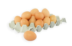 The brown eggs in egg box. Isolate on white background Royalty Free Stock Images