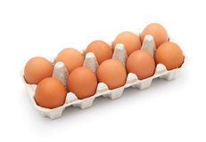 Brown eggs in egg box on white background Royalty Free Stock Photo