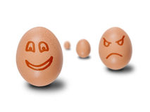 Brown eggs with faces drawn Royalty Free Stock Images