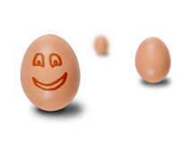 Brown eggs with faces drawn Stock Photography