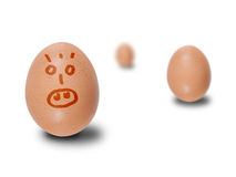 Brown eggs with faces drawn Royalty Free Stock Photo