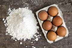Brown eggs and flour Royalty Free Stock Image