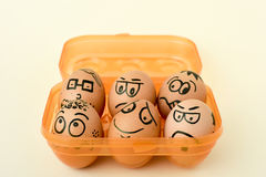 Brown eggs with funny faces Royalty Free Stock Photography
