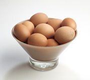 Brown eggs in a glass bowl. Royalty Free Stock Photo