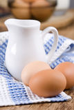 Brown eggs and milk Royalty Free Stock Photography