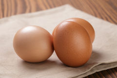 Brown eggs  on napkin over table Stock Images