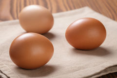 Brown eggs  on napkin over table Royalty Free Stock Photography