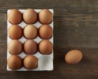 Brown Eggs Over head CloseUp. Brown Eggs Overhead on Wood Stock Photos