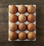 Brown Eggs Over head CloseUp. Brown Eggs Overhead on Wood Stock Images