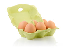 Brown eggs in the package Stock Photos