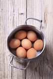 Brown eggs in a pan Stock Photo