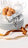 Brown eggs with plates for Easter breakfast Stock Photo