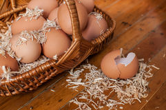 Brown eggs in small basket still life Royalty Free Stock Photos