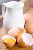 Brown eggs and some milk Stock Photos