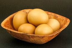 Brown eggs. Some brown eggs on wood plate Stock Photo
