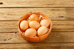 Brown eggs in terracotta bowl Stock Images