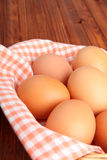 Brown eggs on the vintage cloth in the basket Royalty Free Stock Images