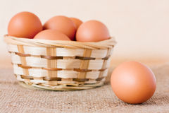 Brown eggs in a wattled basket Royalty Free Stock Photos