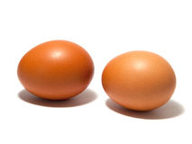 Brown eggs on the white background Royalty Free Stock Images