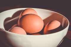Brown Eggs in White Ceramic Bowl Stock Images