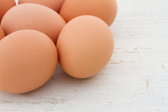 Brown eggs on a white table Stock Photography