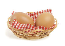 Brown eggs in a Wicker basket. On a white background Royalty Free Stock Images