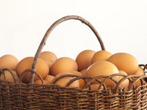 Brown eggs in willow basket Stock Photos