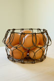 Brown eggs in a wire basket. In natural light Stock Photos