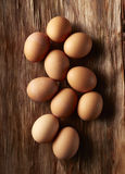 Brown Eggs On Wood. Brown Eggs Overhead on Wood Royalty Free Stock Photography