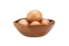 Brown eggs in wooden bowl Stock Photos