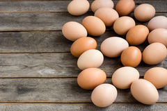 Brown eggs on the wooden grey table. In a farm Royalty Free Stock Photos