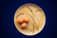 Brown Eggs on Wooden Plate Royalty Free Stock Photo